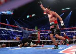 An overjoyed Juan Manuel Marquez celebrates the biggest victory of his hall of fame, terrific career.