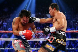 Marquez and Pacquiao fought at a feverish pace, with each man scoring knockdowns.  The momentum was swinging back and forth, until Marquez turned the lights out.