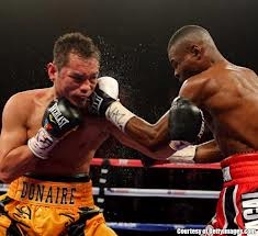 Rigondeaux, pictured right, left the big apple the world's unified, WBA and WBO super bantamweight champion of the world.  Donaire is eating one of the many left hands he received throughout the night.