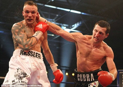 Carl Froch, pictured right, lands a big right hand on Mikkel Kessler in this photo.  Froch would go on to defeat and relinquish Kessler of his WBA super middleweight world championship Saturday night in London.