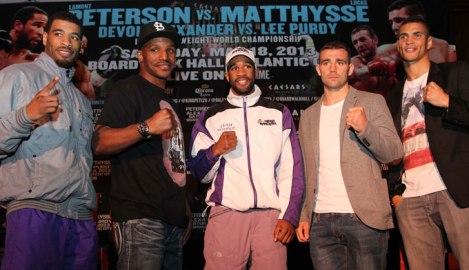 The two main event participants are standing side by side.  Peterson on the left wearing white, and Matthysse standing on the right hand side, are both looking to catapult themselves into a championship showdown with Danny Garcia.