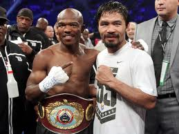 Timothy Bradley and Manny Pacquiao embrace after their controversial first bout.  Despite the mutual respect, their was also a mutual disagreement following the fight by the two fighters.  Pacquiao, and many fans and experts in Boxing, believe Pacquiao won.  The three judges anointed to score the first fight, along with Bradley believe Bradley had deserved his victory.